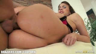 Sultry brunette in lingerie is oiled up and massaged before anal